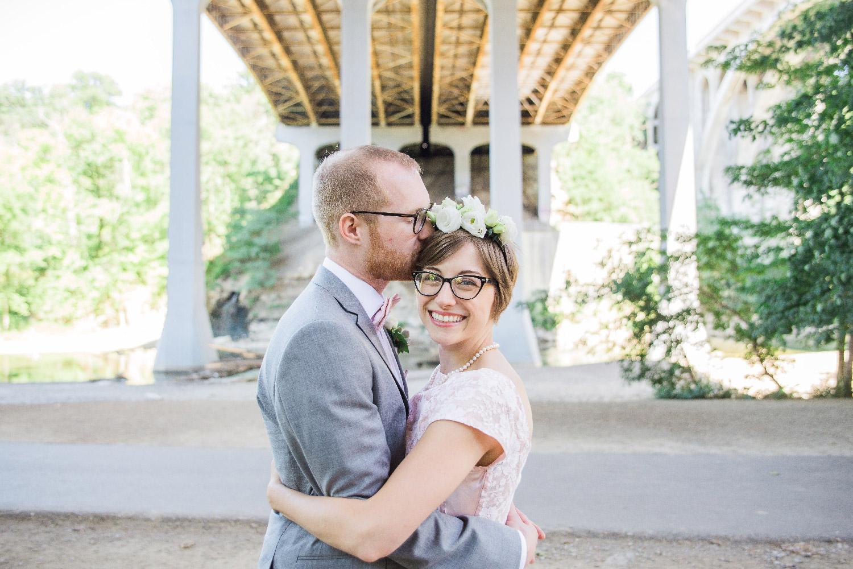 Greg kissing bethany's forehead under bridge for wedding photos Cleveland Ohio Lea Marie Photography