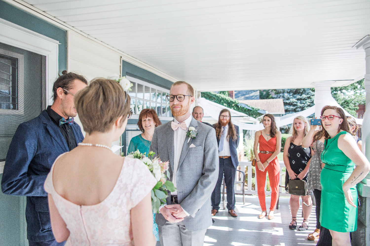 Bethany and Greg exchanging wedding vows on their front porch of their Cleveland Ohio home Lea Marie Photography