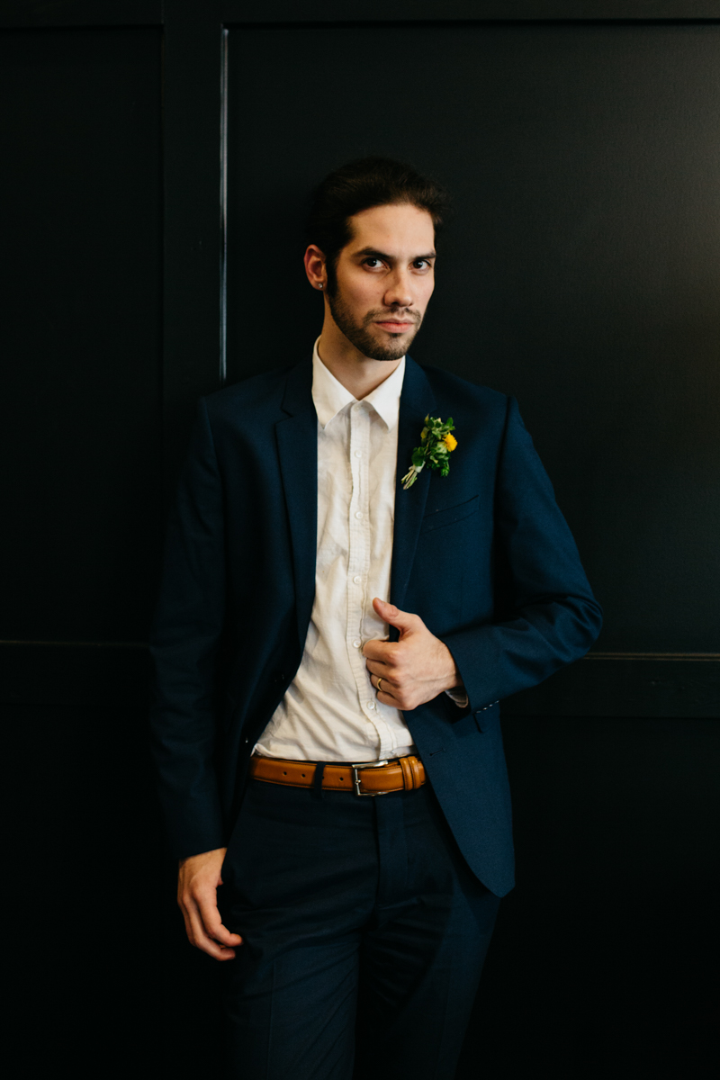 wes anderson inspired wedding styled shoot columbia south carolina groom posing with hand on jacket lapel