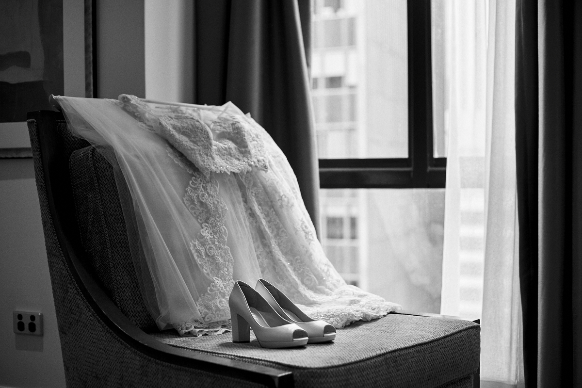Hasara's custom lace white wedding sari and shoes on chair by window in Sydney Australia