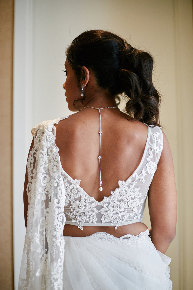 View of hasara's custom lace white wedding sari
