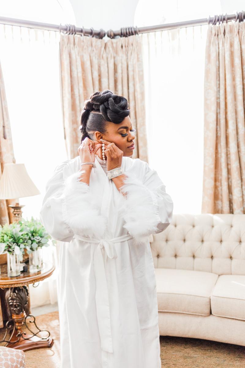 Glam wedding river walk south carolina dana in robe putting on earrings