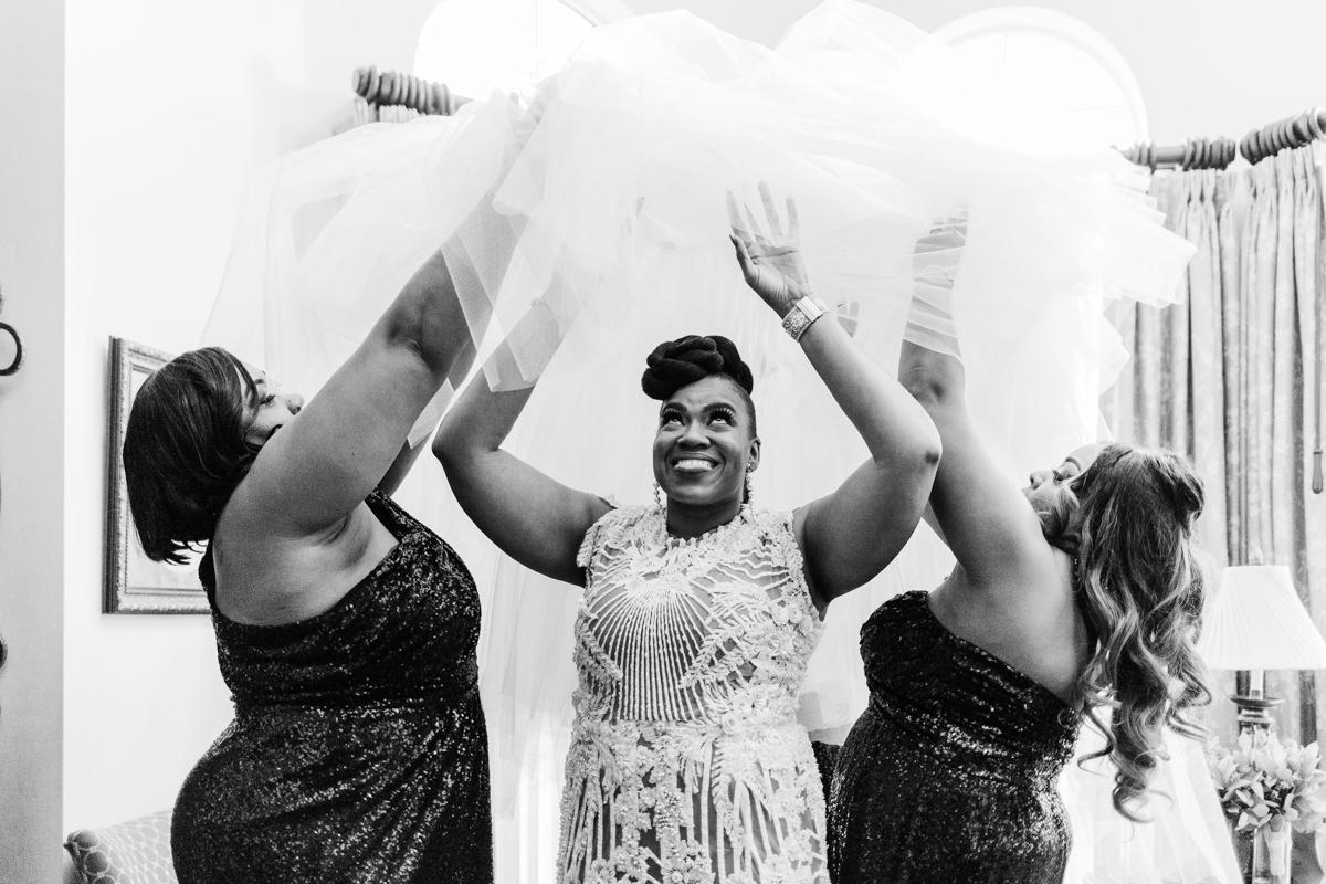 Glam wedding river walk south carolina bridesmaids lifting tulle skirt over dana's dress