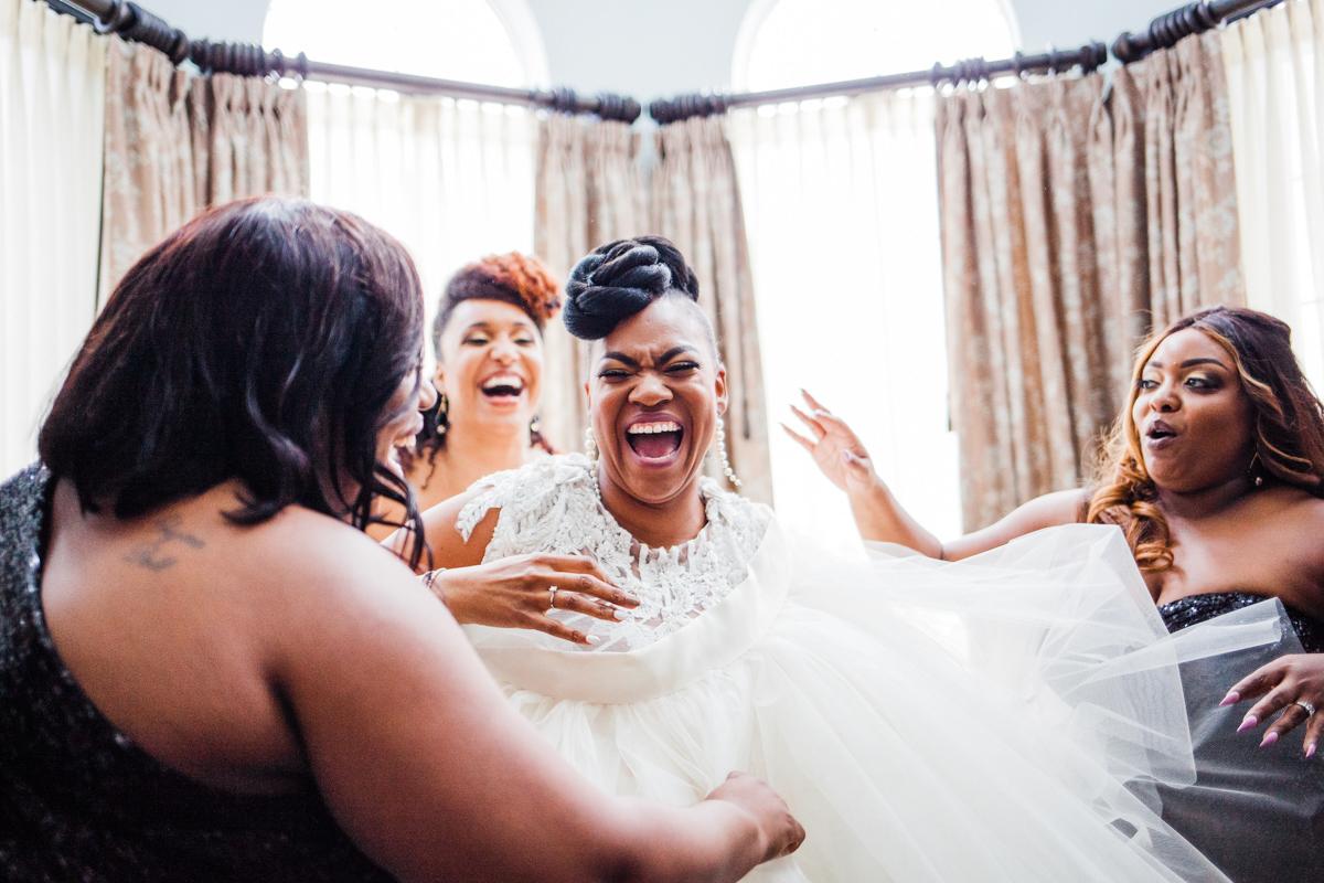 Glam wedding river walk south carolina candid bride laughing with bridesmaids