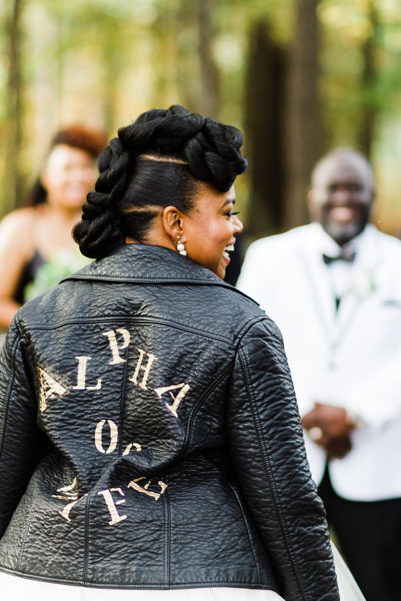 "glam wedding river walk south carolina back of dana's leather jacket reading ""alpha wife for life"""