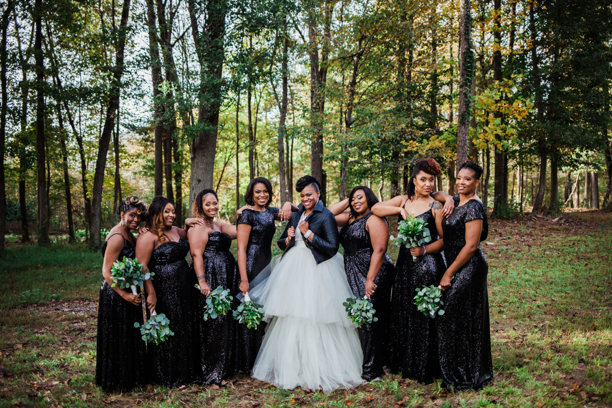 glam wedding river walk south carolina bride and bridesmaids in forest clearing