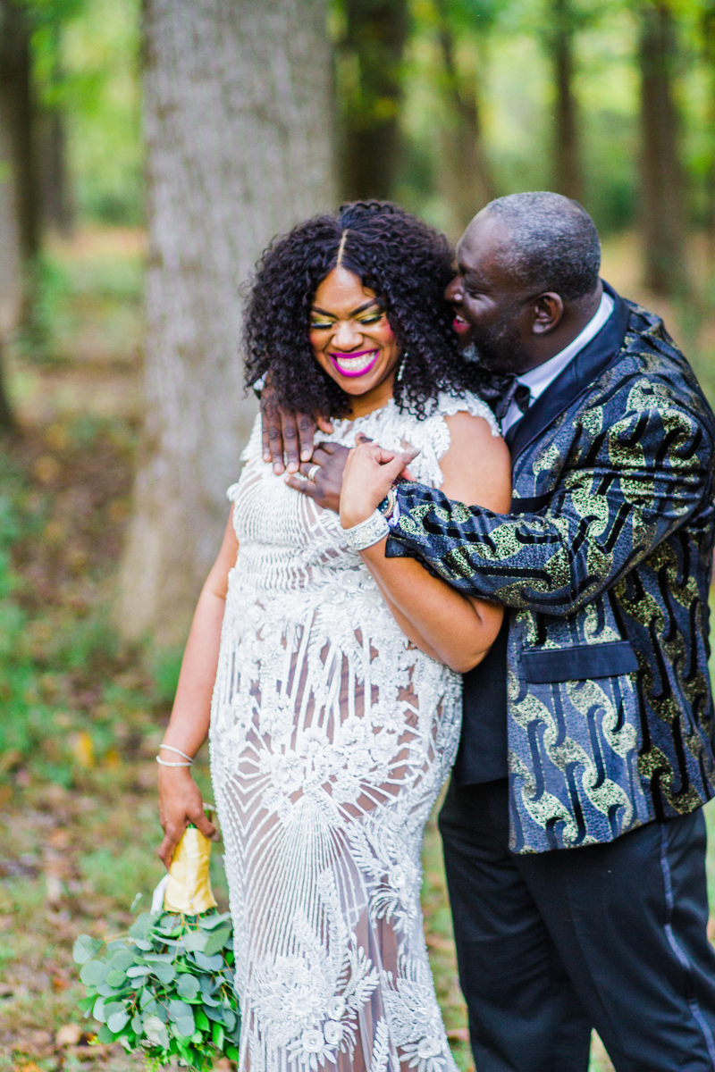 glam wedding river walk south carolina embrace in clearing laughing candid