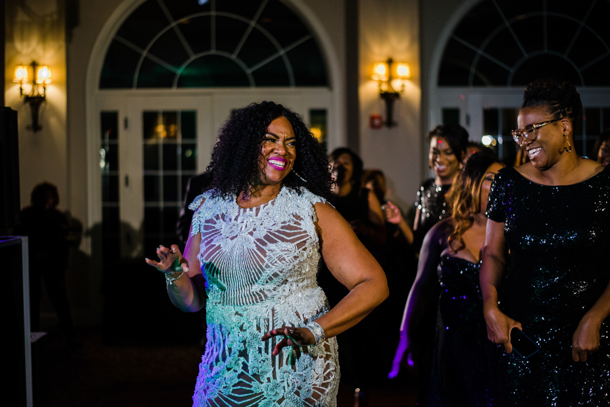 glam wedding river walk south carolina dana and bridesmaids dancing
