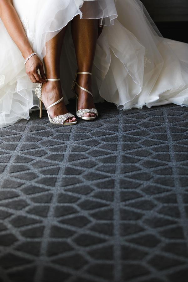 african american, christian, and muslim traditions minneapolis wedding Taara fastening glittery wedding heels