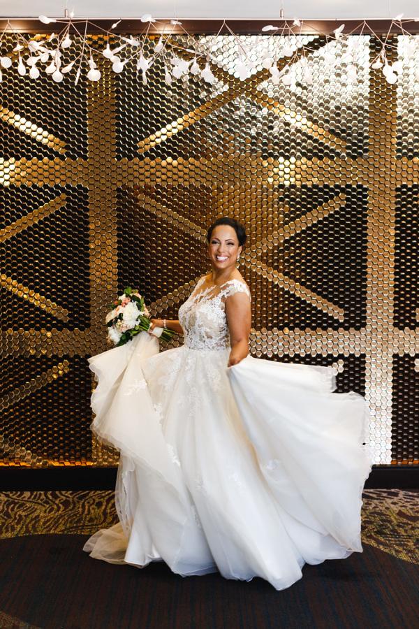 african american, christian, and muslim traditions minneapolis wedding taara twirling in wedding dress