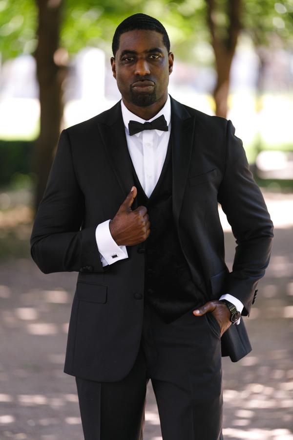 african american, christian, and muslim traditions minneapolis wedding glenn i tuxedo posing on outside path