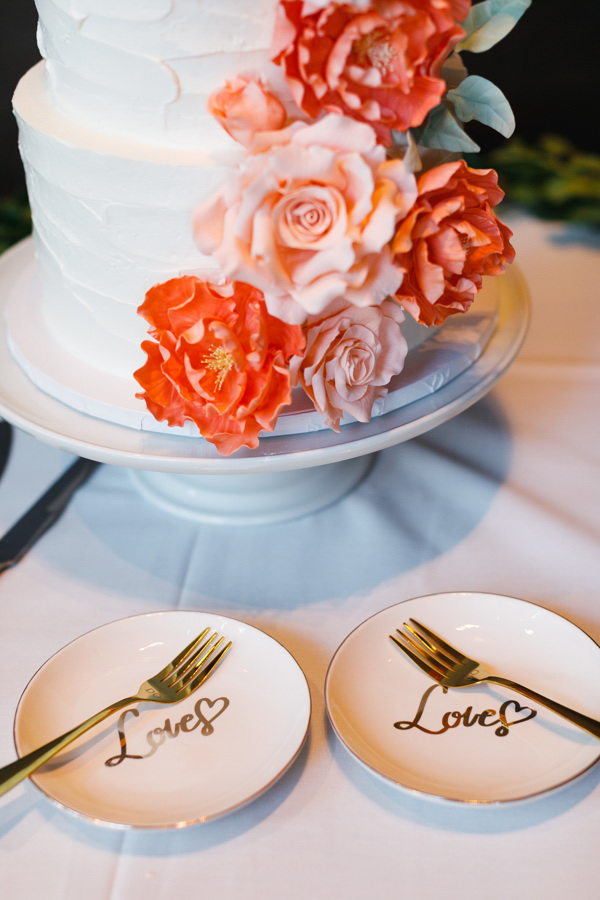 """african american, christian, and muslim traditions minneapolis wedding cake with frosted flowers and couples' plates reading """"love"""""""