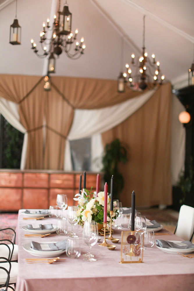 Modern traditional blended styled shoot new york table for six guests, large curtained window in background