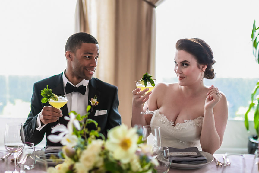 Modern traditional blended styled shoot new york bride and groom at table having drinks