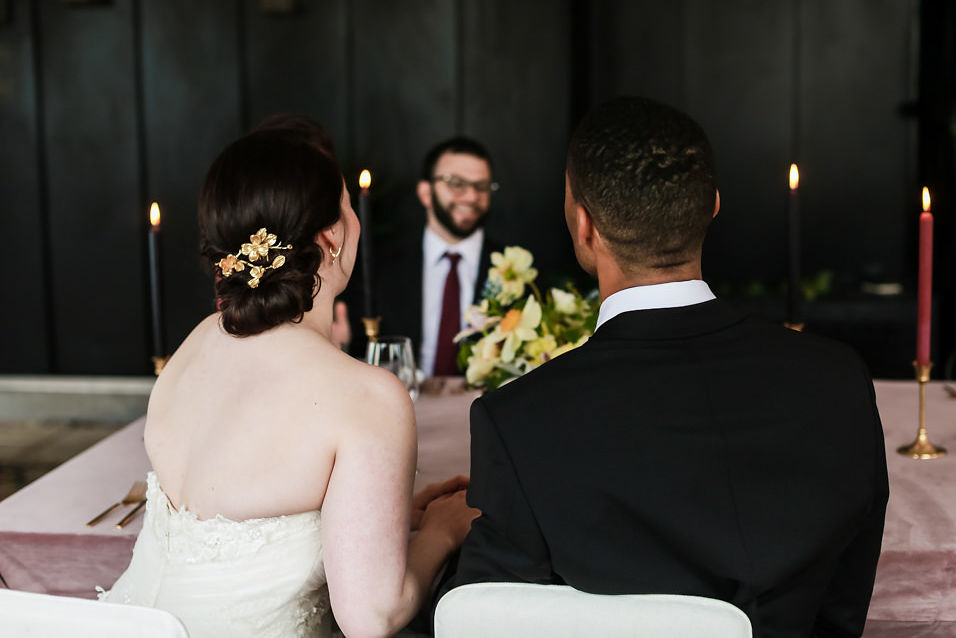 Modern traditional blended styled shoot new york couple from behind talking to guest