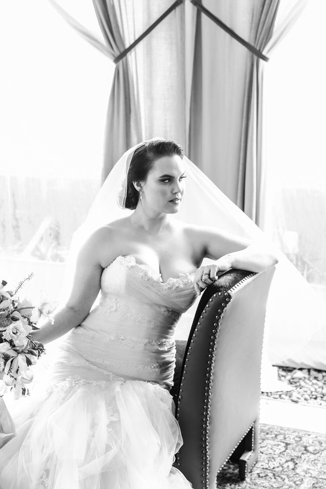 Modern traditional blended styled shoot new york bride holding bouquet on chair