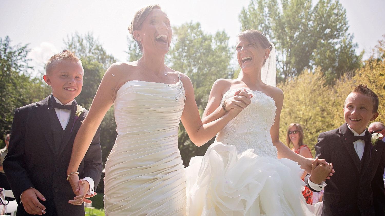 two brides holding hands connecticut wedding photographer Teresa Johnson