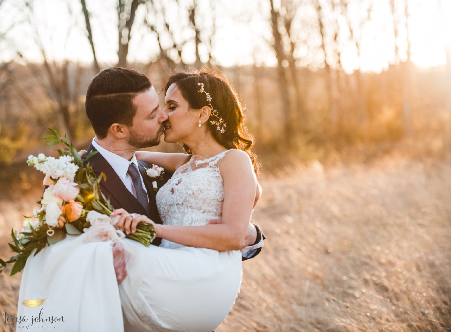 groom holding up bride about to kiss in a grassy field connecticut wedding photographer Teresa Johnson