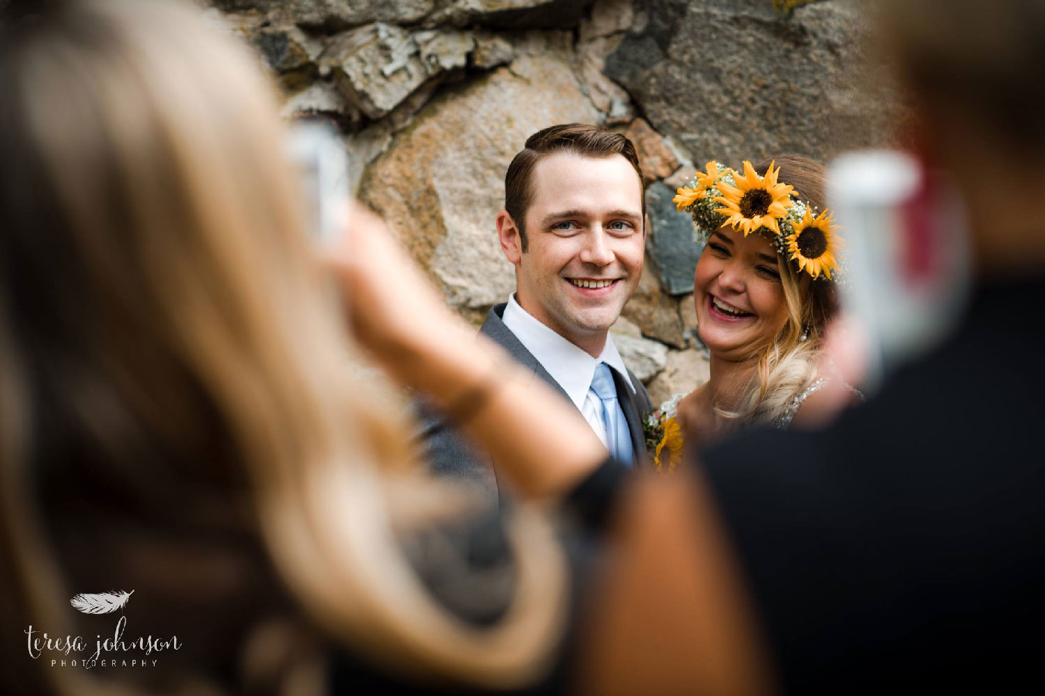 groom and bride wearing sunflower crown posing for photos connecticut wedding photographer teresa johnson