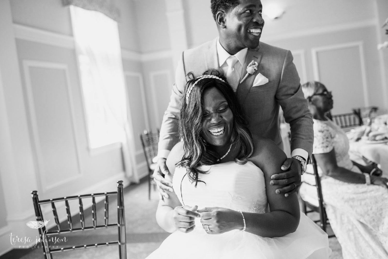 newlywed couple embracing at reception connecticut wedding photographer Teresa Johnson
