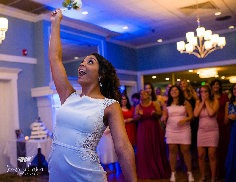 bride throwing bouquet at wedding reception by connecticut wedding photographer teresa johnson