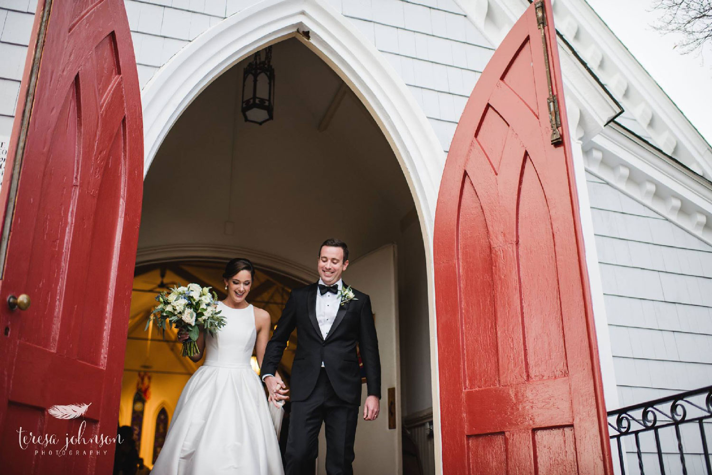 newlywed bride and groom leaving red church doors connecticut wedding photographer Teresa Johnson