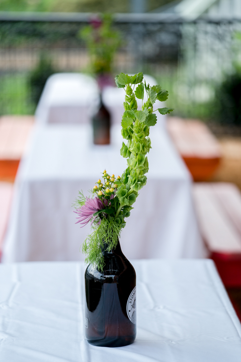Brewery wedding washington D.C. green centerpiece with hopps in dark bottle