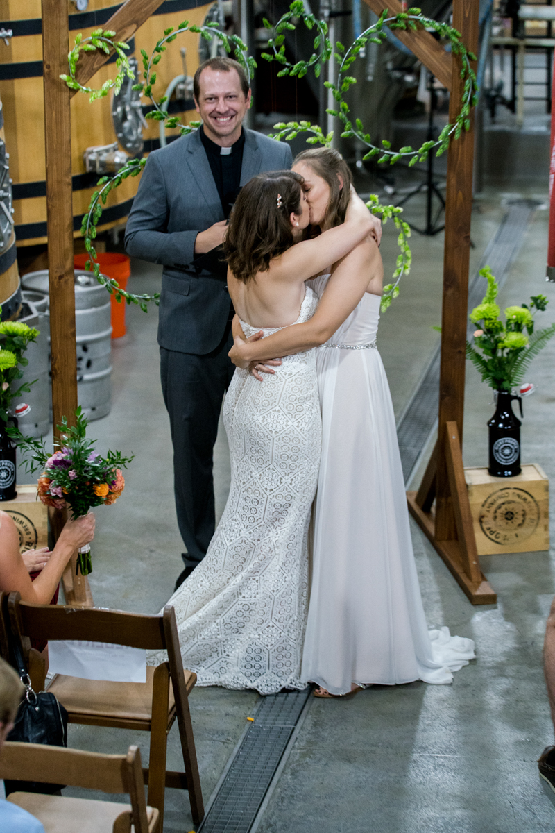 Brewery wedding washington D.C. ceremony kiss