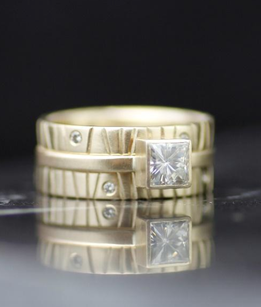 combination stack solitaire engagement ring and textured wedding band with diamonds