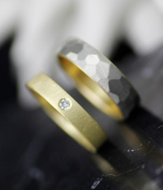 textured silver and gold wedding band and gold wedding band with single inset diamond