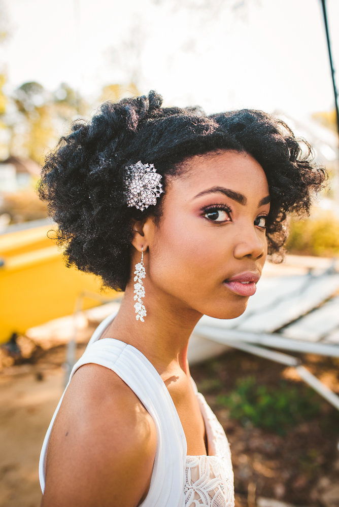 wedding inspiration the boathouse at sunday park midlothian virginia bride with jewel hair clip and dangling floral earrings
