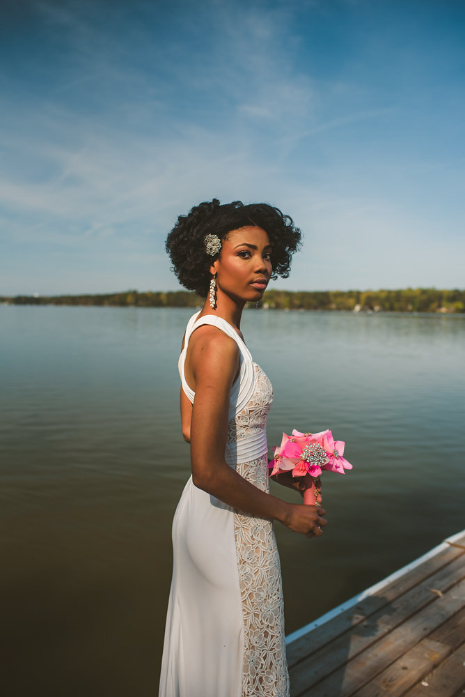 wedding inspiration the boathouse at sunday park midlothian virginia bride by river holding paper flower bouquet