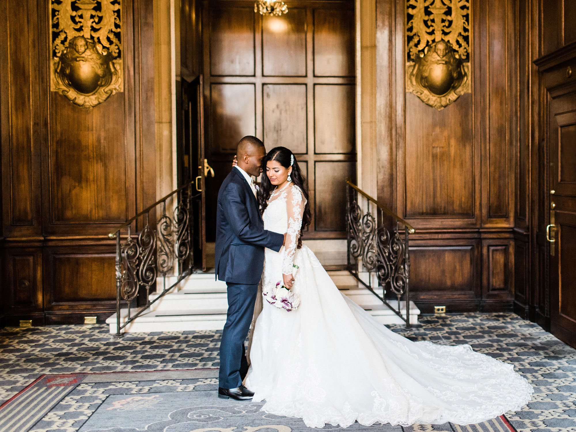 bride and groom standing in luxurious venue at their wedding Apollo Fotografie San Francisco
