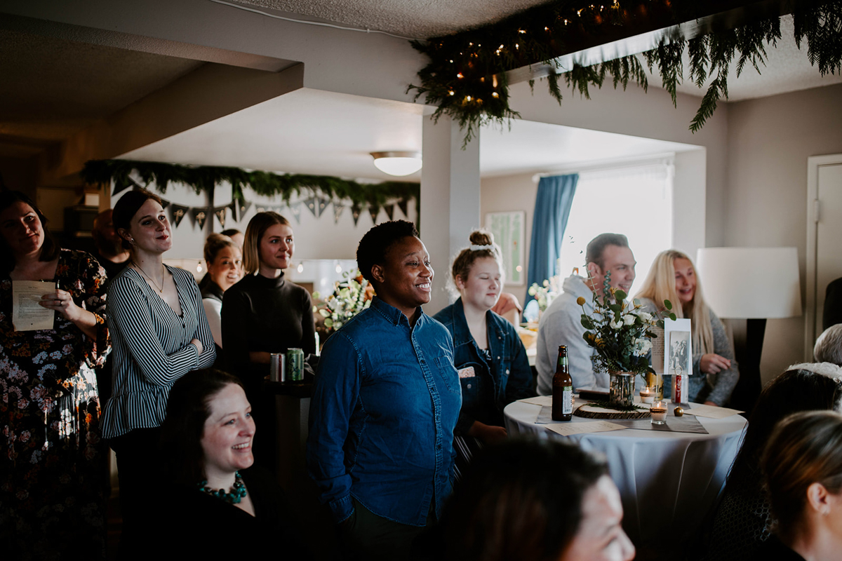 queer surprise home wedding guests during ceremony