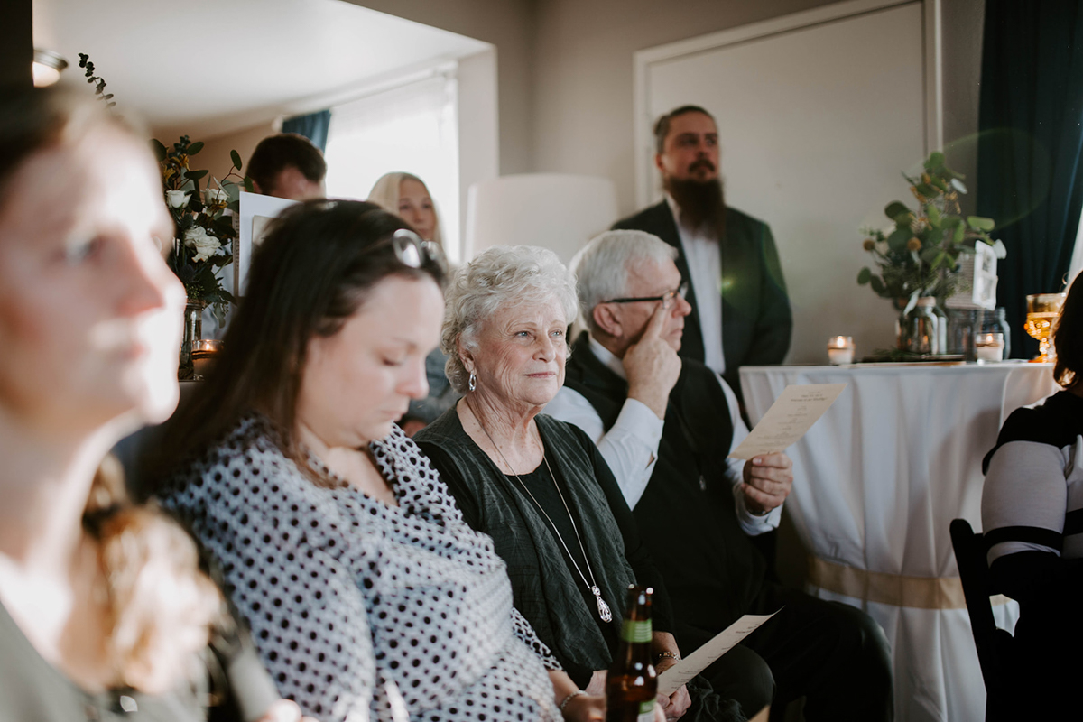 queer surprise home wedding guests at ceremony