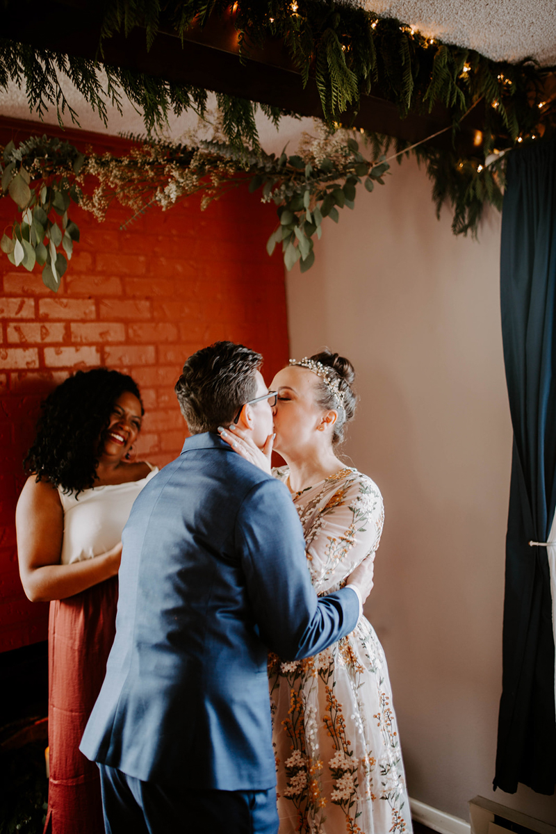 queer surprise home wedding ceremony kiss