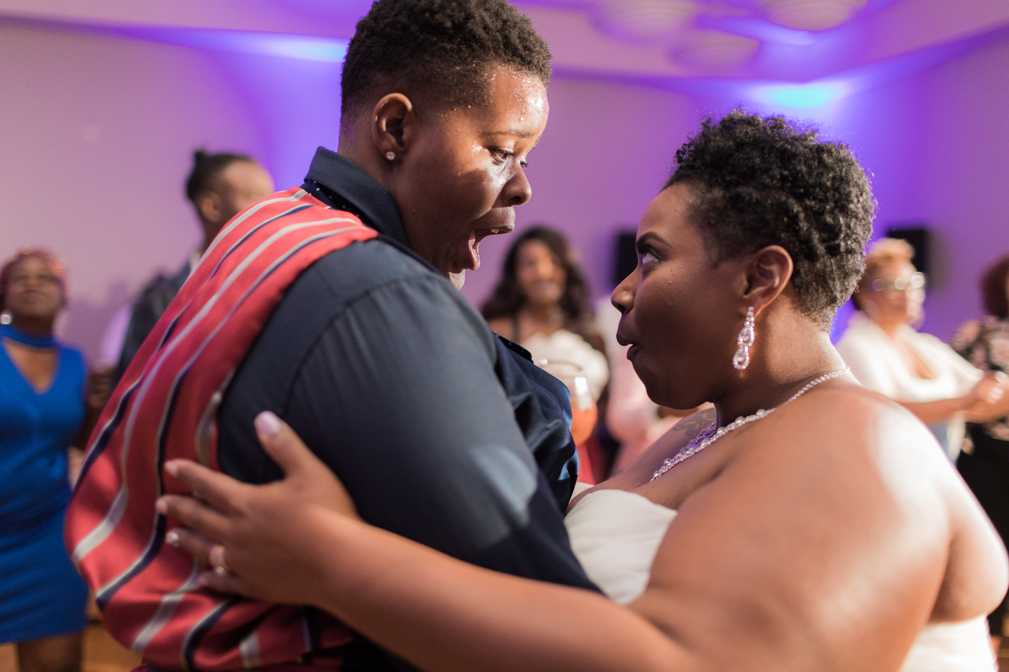 black newlywed couple dancing and laughing on the dance floor at their wedding reception Meera Graham Photography Missoula Montana