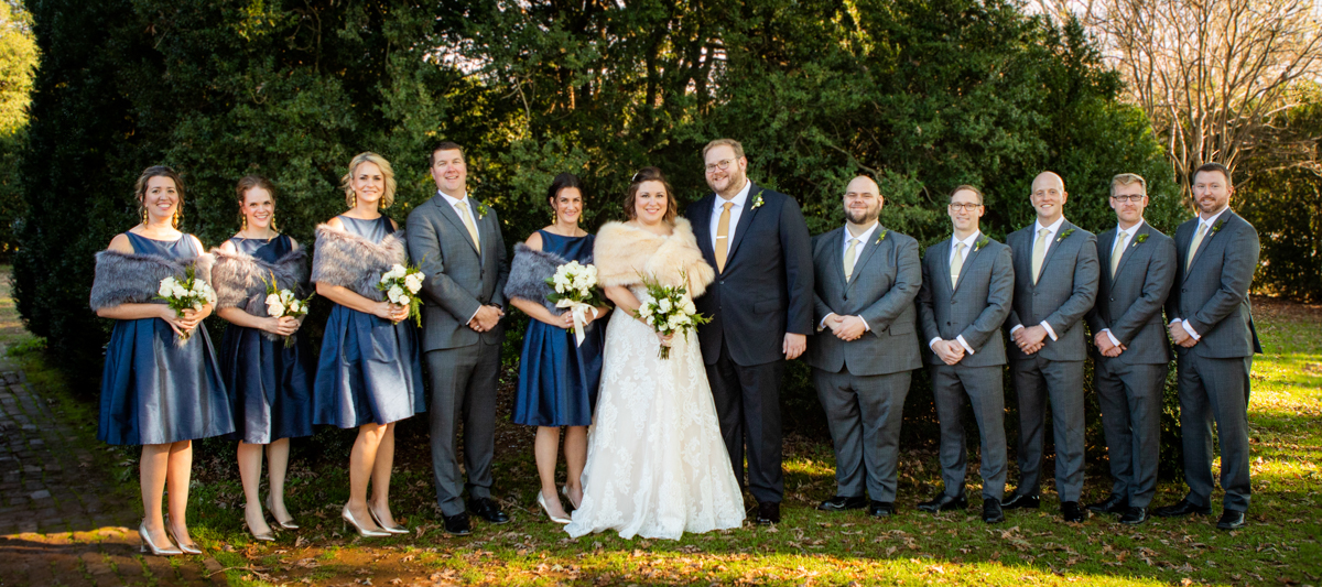 Romantic, Intimate-Feeling Wedding wedding party in front of large tree