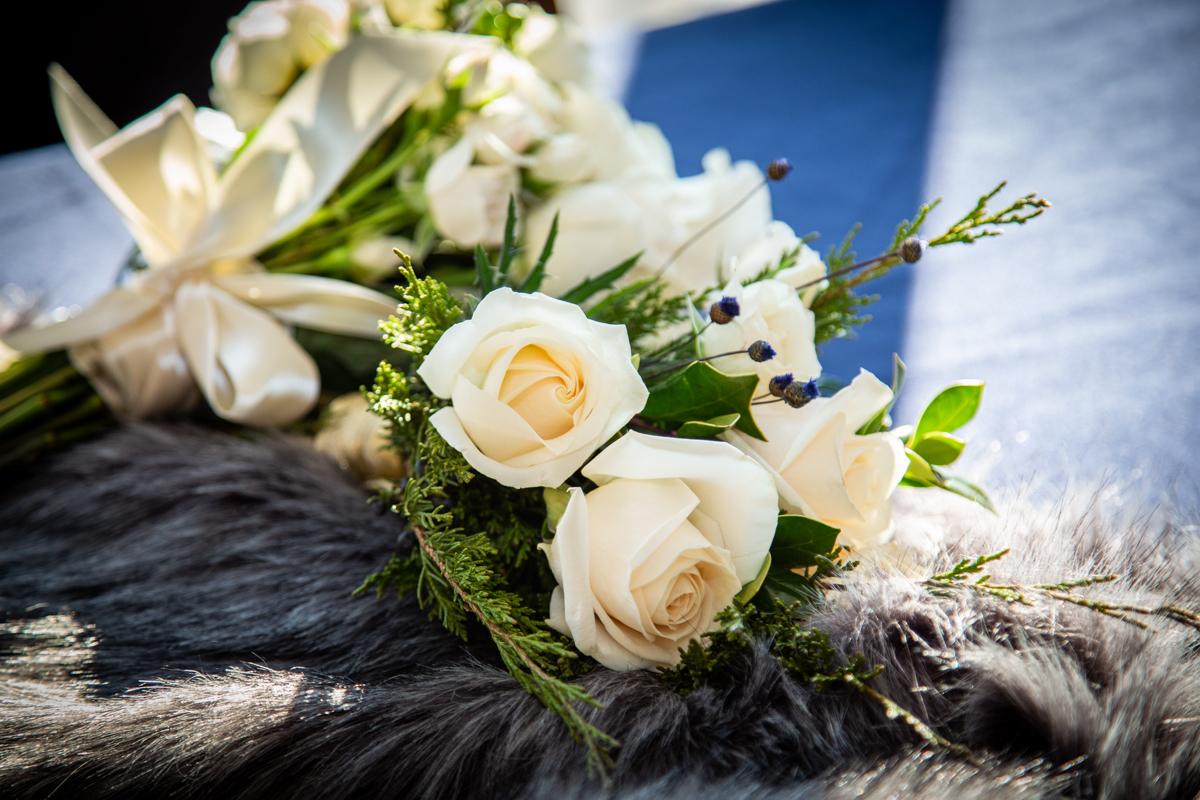 Romantic, Intimate-Feeling Wedding bouquet on fur shawl