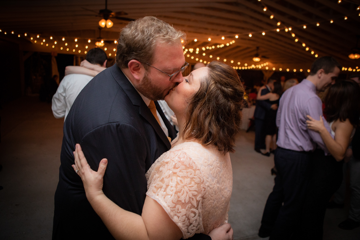 Romantic, Intimate-Feeling Wedding caroline and jon kiss on dance floor