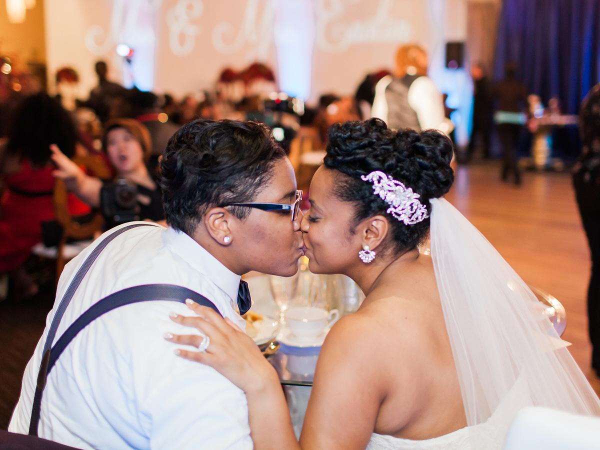 los altos lutheran same-sex wedding brides kiss at main table