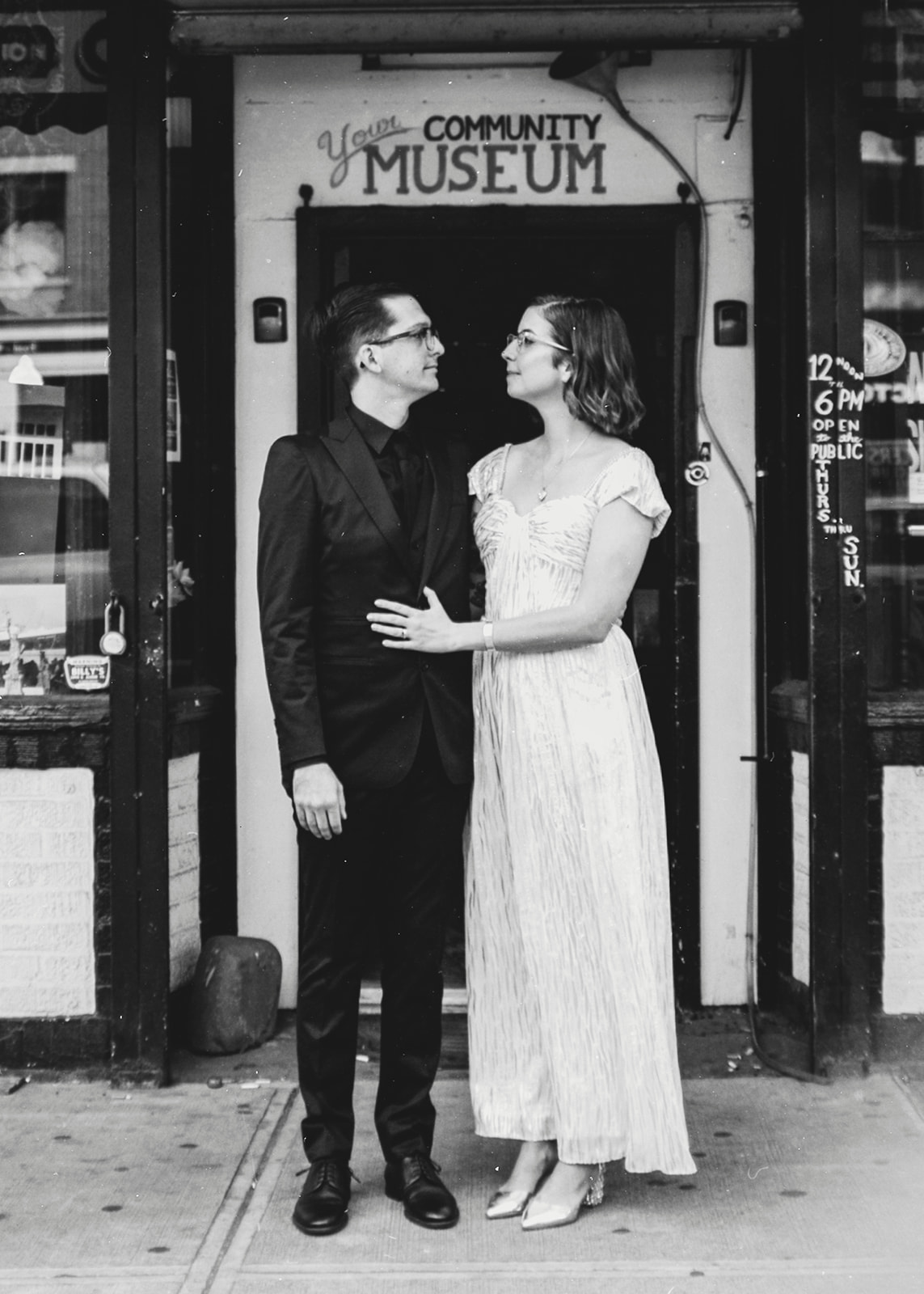 Newlywed couples looking at each other for portrait in front of community museum by Austin Texas LGBTQ friendly photographer Ziggy Shoots