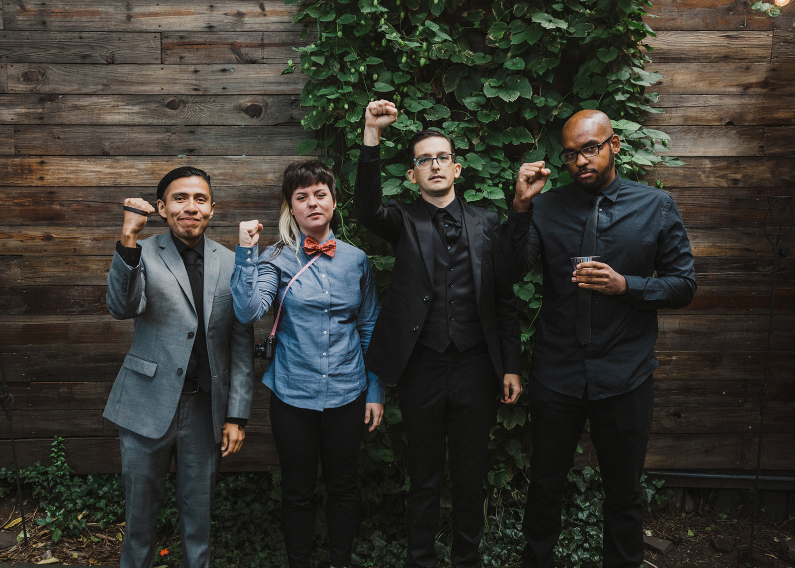 Groom and guests raising up fists in solidarity at wedding by Austin Texas LGBTQ friendly wedding photographer Ziggy Shoots