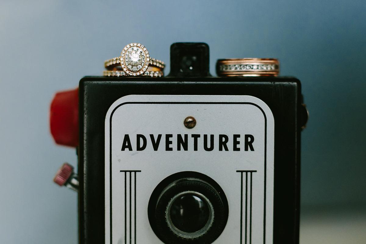wes anderson inspired wedding brooklyn new york rings on vintage camera