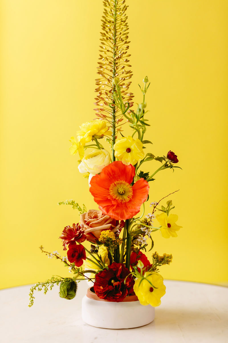wes anderson inspired wedding brooklyn new york tall floral arrangement