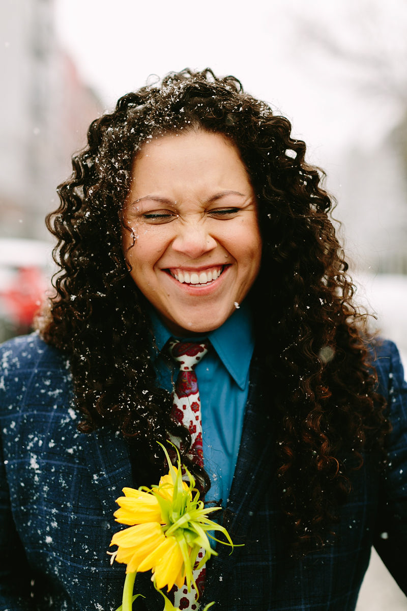 wes anderson inspired wedding brooklyn new york model smiling as snow falls