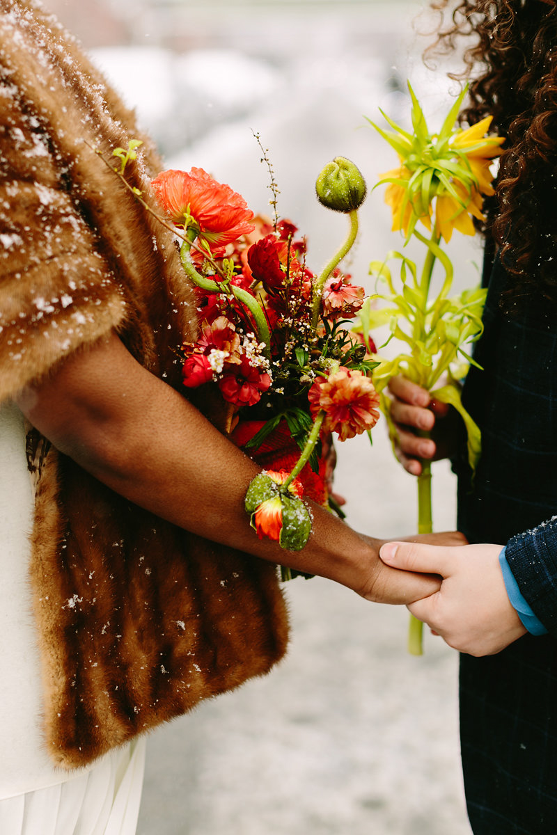wes anderson inspired wedding brooklyn new york couple holding hands