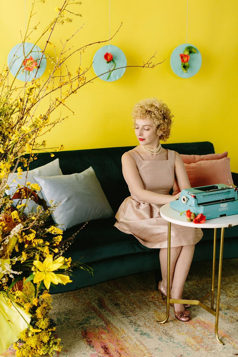 wes anderson inspired wedding brooklyn new york haiku guys + gals writer sitting at typewriter