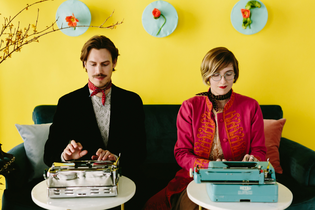 wes anderson inspired wedding brooklyn new york haiku guys + gals writers typing on typewriters