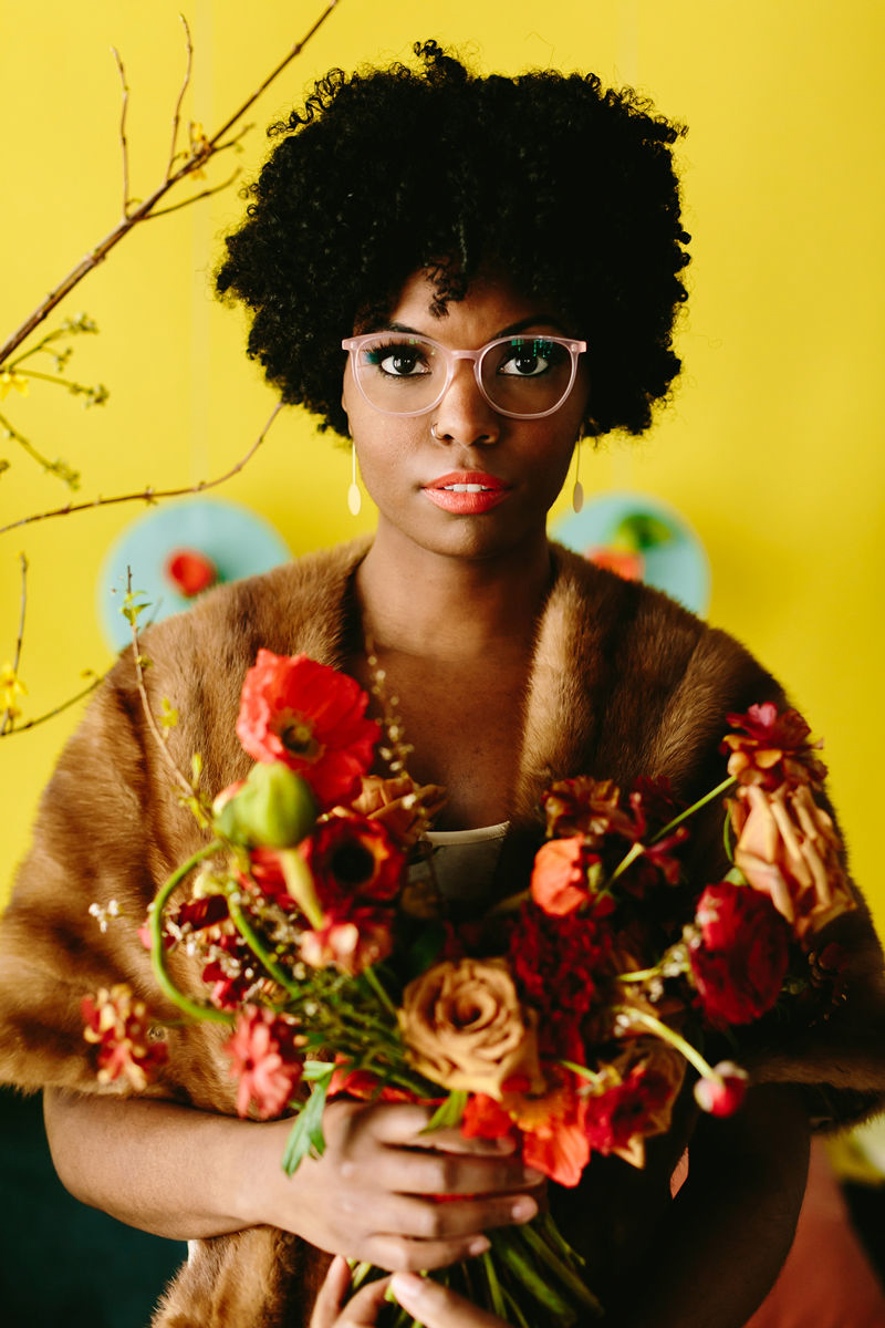 wes anderson inspired wedding brooklyn new york model in fur coat holding bouquet